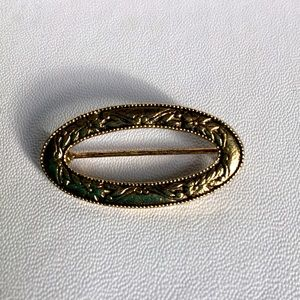 Vintage elliptical floral metal brooch